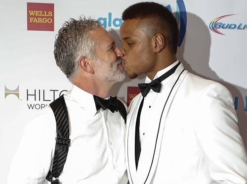 Actor Gerald McCullouch and college basketball player Derrick Gordon kiss during 25th Annual GLAAD Media Awards in New York