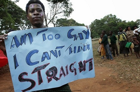 epa03341640 Gay and lesbian activists attend Uganda's first gay pride parade and celebration at the Entebbe Botanical Gardens, Kampala, Uganda, 04 August 2012. Both male and female homosexual activity is illegal in Uganda. The parade took place the day after US Secretary of State Hillary Clinton praised activists who opposed a tough draft law in Uganda targeting gays and lesbians. She called them an inspiration for others struggling to secure equal rights around the world.  EPA/RACHEL ADAMS